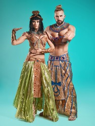 The man, woman in the images of Egyptian Pharaoh and Cleopatra