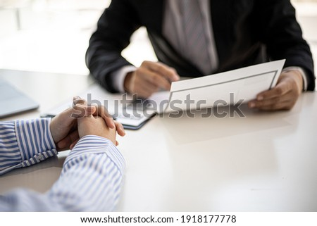 The manager is explaining information about the job position being hired to the job applicant, the manager explains the job qualifications, salary benefits. Job application ideas.
