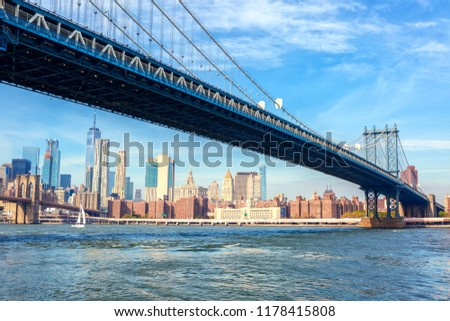 The Manhattan Bridge with  Manhattan in the background at the day-time, New York City, United States. #1178415808