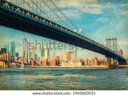 The Manhattan Bridge with Manhattan in the background at the day-time, New York City, United States. Photo in retro style. Added paper texture. #1442860025