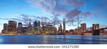 The Manhattan skyline and Brooklyn Bridge as seen from across the East River at dusk. New York City at night #341275280