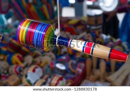 The maraca hangs from the thread. #1288830178