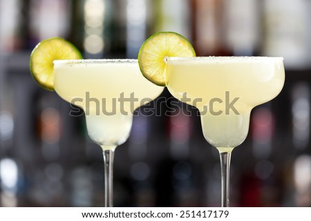 The margarita is a cocktail consisting of tequila mixed with orange-flavoured liqueur and lime or lemon juice, often served with salt on the glass rim.