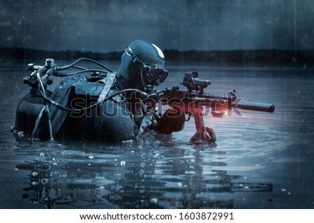 The marine comes out of the water and moves toward the target with weapons in hand. The concept of video games, advertising, instability in the world, country conflicts. Mixed media