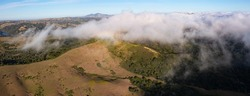 The marine layer sweeps over the serene hills of the East Bay, just east of San Francisco Bay, California. This area has a number of parks and open spaces available to explore by hiking and biking.