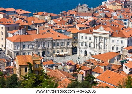 The Market Square in the Slovenian town Piran on the Adriatic Coast. Taken from a high vantage point with a telezoom lens. - stock photo