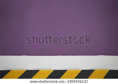 the markings drawing attention to the wall are painted in yellow and black stripes, with a purple background divided by a white stripe #1404436121