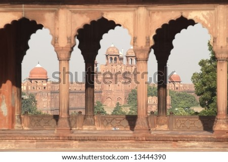 The massive walls and entrance to the Red Fort as seen from the courtyard of the main mosque in Old Delhi, India