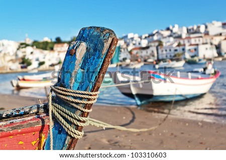 The mast of the old boat on the shore of Ferragudo. Seascape.