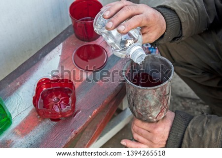 The master who paints the car prepares a suitable mixture of paint for painting in a bowl. Stock photo ©