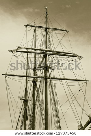 The masts and rigging boat in the port of Reykjavik city, Iceland (stylized retro)