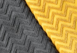 The material is textile with a zigzag pattern. Two popular trending colors. Color of the Year 2021. Illuminating Yellow and Ultimate Gray.