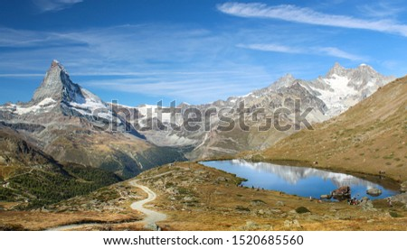 The Matterhorn and the alpine lake Stellisee in Zermatt, Switzerland. Switzerland landmark. #1520685560
