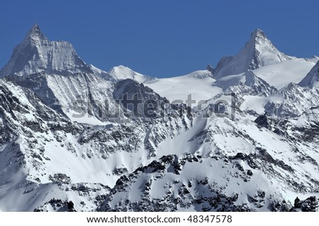 The matterhorn and the Dent d'Herens in the Swiss alps in the winter