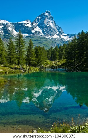 the Matterhorn reflected in the clear waters of blue lake, Valtournenche - Aosta Valley #104300375