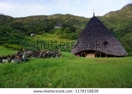 The mbaru niang, house of friendly tribe in wae rebo and the pile of stones is the tomb of ancestor's of the comunity. #1178118838