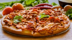 The meat lover pizza is served at Pizza restaurant.
