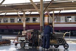 The mechanic is writing draft information to prepare for repair work in the train station.