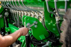 The mechanics repair combine harvester. Modern agricultural machinery