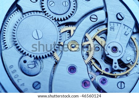 The mechanism of analog hours - blue tone. A photo close up