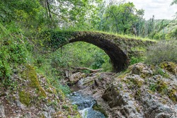 The Medieval Bridge of La Nava in the mountains of Huelva. Located on a bend in the Murtigas River, this bridge is well preserved and although many call it roman bridge, it was built in 1484.