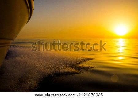 The Mediteeranean Sea offer us amazing sunsets like this over the vast extensions of the sea from the boat, Spain