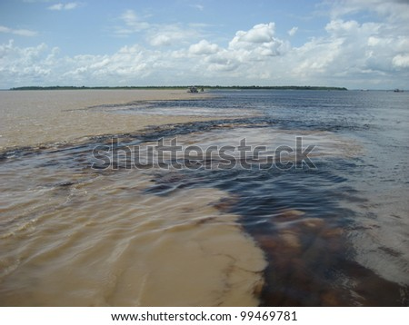 The Meeting of Waters (Portuguese: Encontro das Aguas) is the confluence between the Rio Negro, a river with dark (almost black coloured) water, and the sandy-coloured Amazon River or Rio Solimoes.