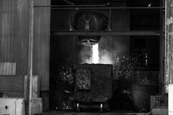 The melting metal is pouring into the melting pot of the carriage in the industrial foundry plant. The manufacture of cast metal relies on furnace technologies, since metals usually melt at very high.