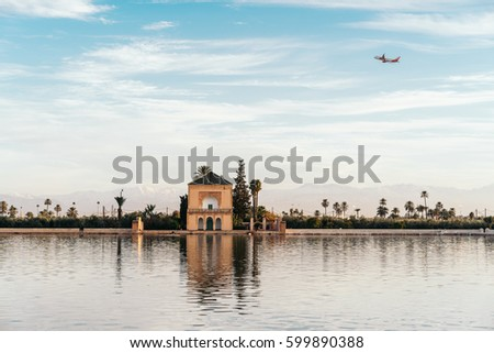 The Menara gardens at dusk. They are botanical gardens located to the west of Marrakech, Morocco, near the Atlas Mountains.