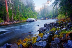 The Merced River flowing through Yosemite National Park at sunrise (HDR).