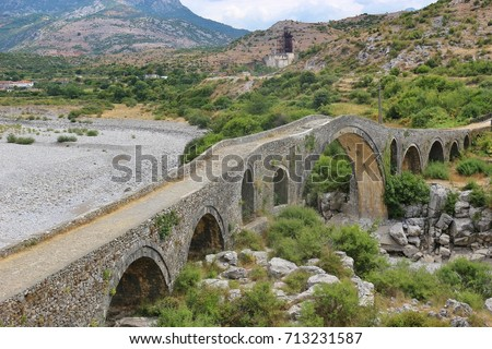 The Mesi bridge in Mes, Albania, near Shkoder. An old stone bridge built by the Ottomans in 1770, now a tourist attraction. North Albania, Southeast Europe.