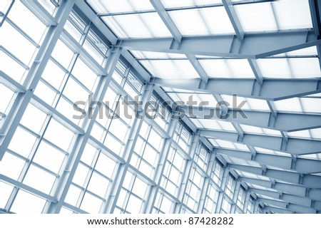 the metal and glass roof of a mall