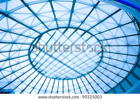 the metal and glass roof of a mall.