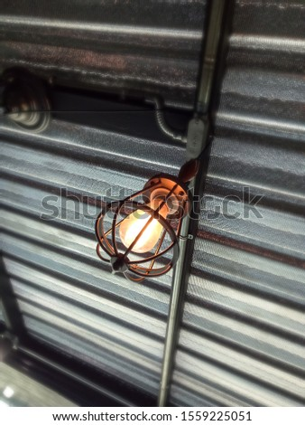 The metal cage lamp is used for illuminating the interior and exterior. #1559225051