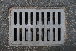 The metal cover for the drainage on the street