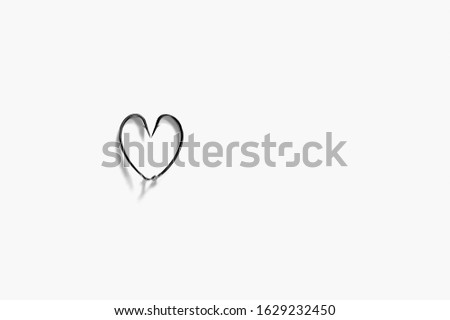 The metal hooks placed heart symbols isolated on a white background. Fishing hook close up. Fishing tackle. Stainless steel hooks. Fish hooks in heart shape. Concept love fishing. Space for text.