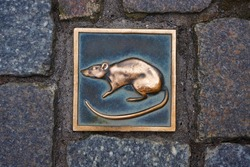The metal rat - symbol of city Hameln in Germany under legend of the Pied Piper of Hamelin.