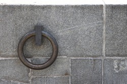 The metal ring in the granite wall symbolizes the chains of non-freedom