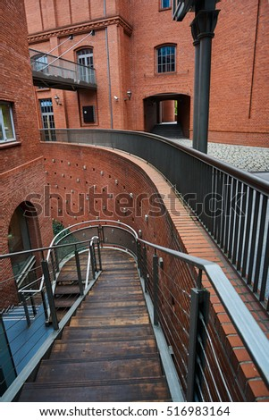 The metal structure  and brick wall in an old brewery in Poznan #516983164