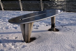 The metallic fishing table on the cold white snow in New York City
