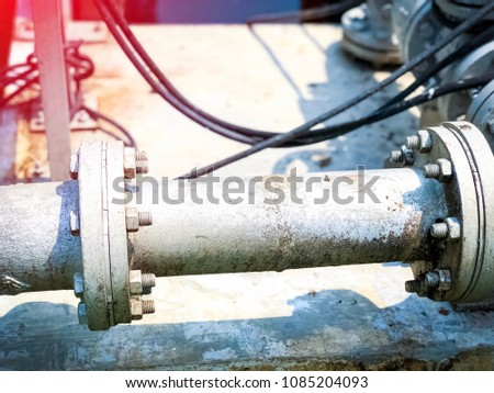 The metallic pipeline in the waste water treatment and management system, use as a background in industrial or factory. Selective focus and blur background. #1085204093