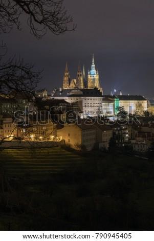 The Metropolitan Cathedral of Saints Vitus, Wenceslaus and Adalbert is a Roman Catholic metropolitan cathedral in Prague, the seat of the Archbishop of Prague. At night.  #790945405