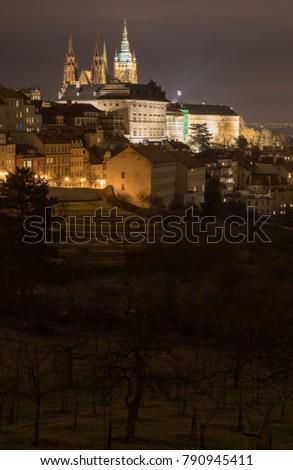 The Metropolitan Cathedral of Saints Vitus, Wenceslaus and Adalbert is a Roman Catholic metropolitan cathedral in Prague, the seat of the Archbishop of Prague. At night.  #790945411