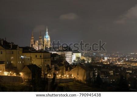 The Metropolitan Cathedral of Saints Vitus, Wenceslaus and Adalbert is a Roman Catholic metropolitan cathedral in Prague, the seat of the Archbishop of Prague. At night.  #790945438