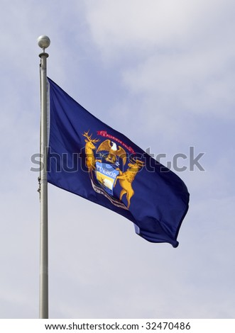 The Michigan state flag waving in the wind.