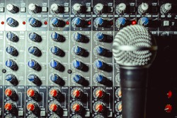 the microphone rests on an audio mixer