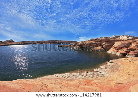 The midday sun in the turquoise water bay. Bottling magnificent Lake Powell