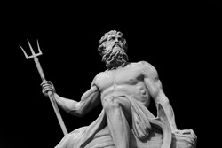 The mighty god of the sea and oceans Neptune (Poseidon) The ancient statue isolated on black background.