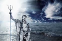 The mighty god of the sea and oceans Neptune (Poseidon). The ancient stone statue against dramatic sea landscape.