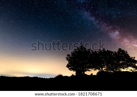 The Milky Way along the rock walls up to 160 meters high of the famous Swiss canyon Creux du Van. Night stellar sky in the Jura mountains between Canton Neuchâtel and Vaud, Switzerland, Europe